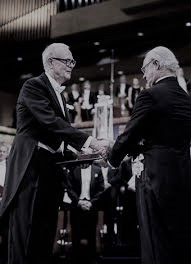 Patrick Modiano receiving his Nobel Prize from His Majesty King Carl XVI Gustaf of Sweden